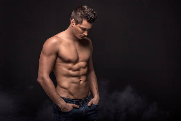 Handsome shirtless man in studio. Handsome shirtless man posing on black studio background. shirtless male models stock pictures, royalty-free photos & images