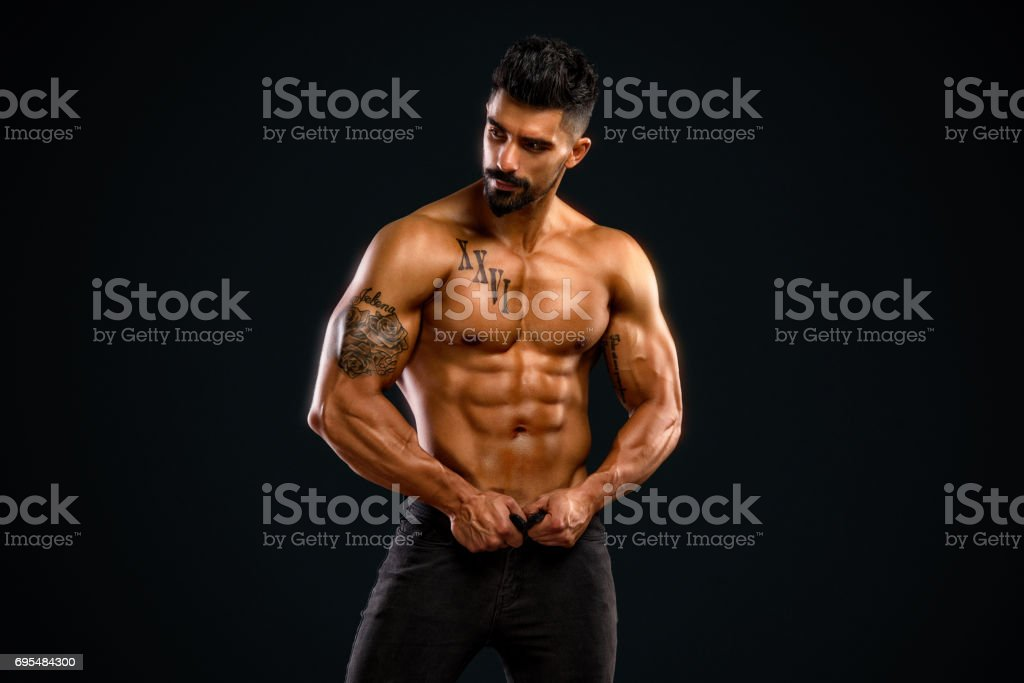 Handsome Shirtless Men in Jeans stock photo