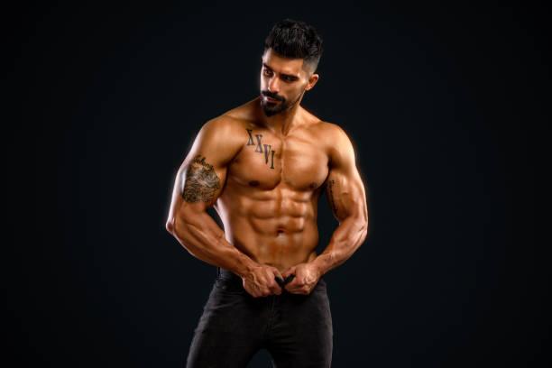 handsome shirtless men in jeans - a petto nudo foto e immagini stock