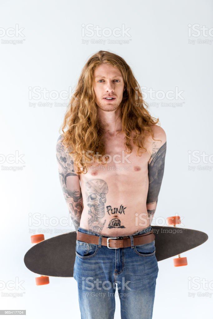 handsome shirtless tattooed sportsman with ginger hair standing with longboard isolated on white royalty-free stock photo
