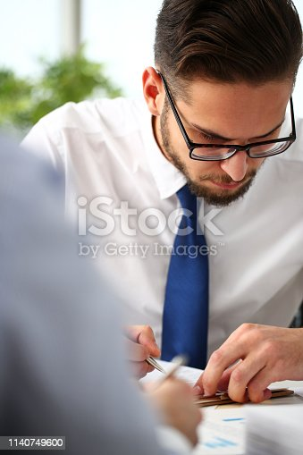 istock Handsome smiling bearded clerk man at office workplace 1140749600