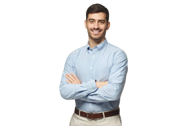 handsome smiling business man in blue shirt standing with crossed arms, isolated on white background - executivo imagens e fotografias de stock