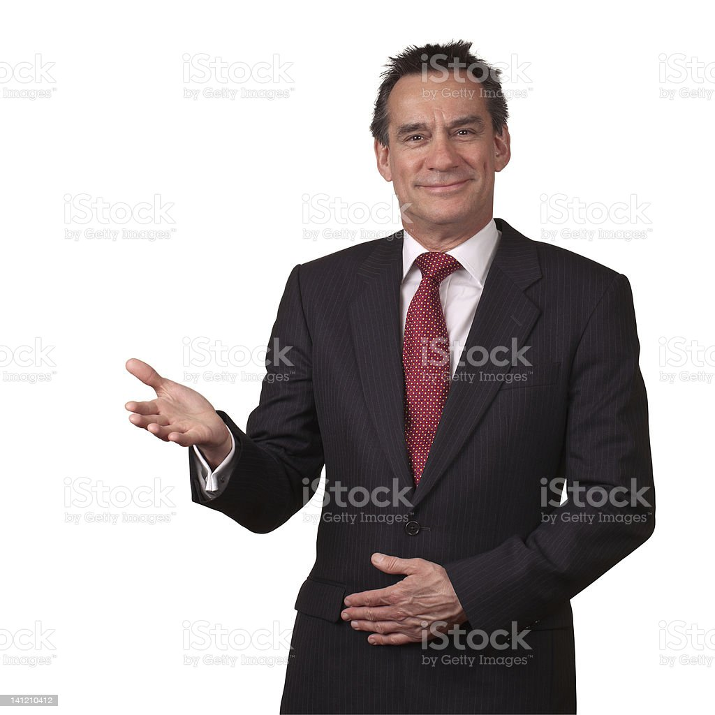 Handsome Smiling Business Man in Suit Gesturing Welcome royalty-free stock photo