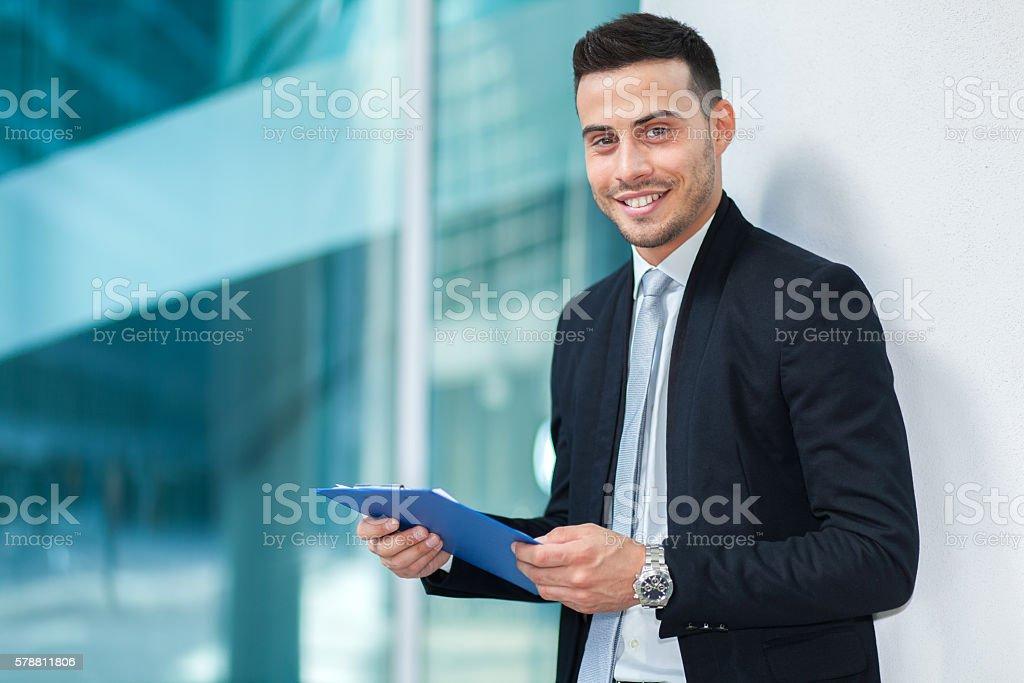 Handsome smiling businessman portrait outdoor stock photo