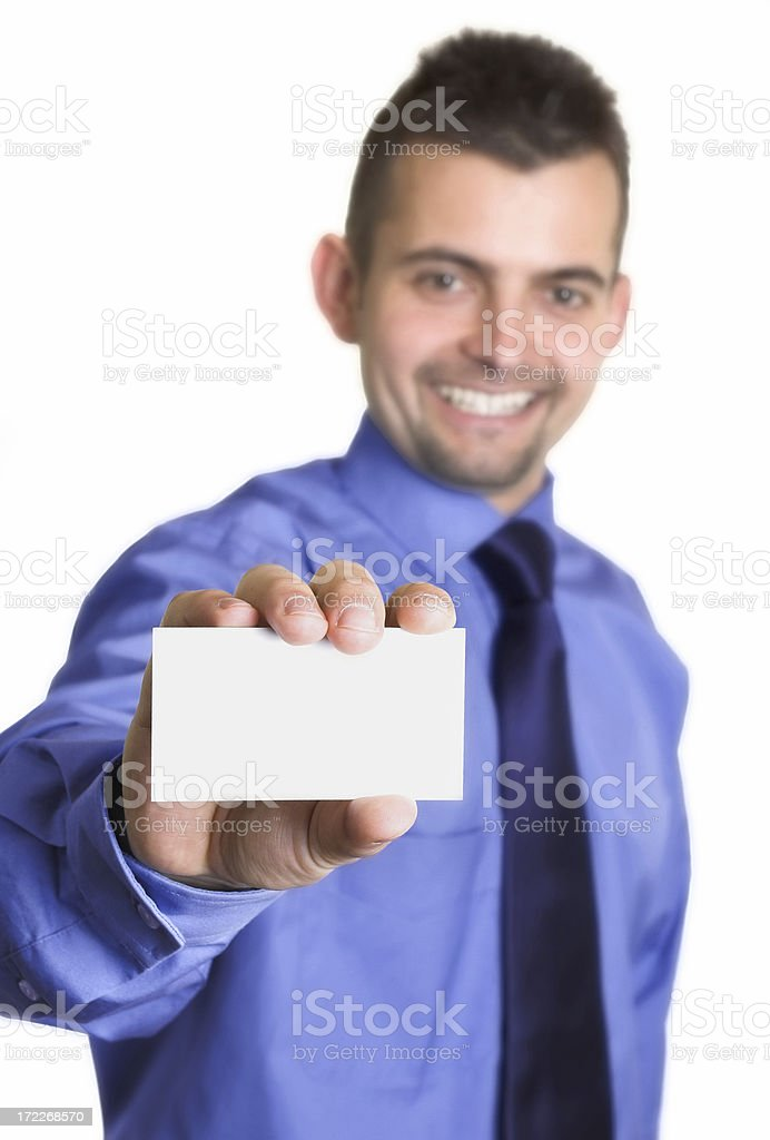Handsome smiling businessman showing his businesscard royalty-free stock photo