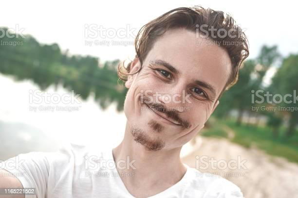 Handsome smiling caucasian guy takes a selfie at the beach people picture id1165221502?b=1&k=6&m=1165221502&s=612x612&h=n47v3sdvlhblfghnoto bkhglkv opjneeozd1vjhcc=