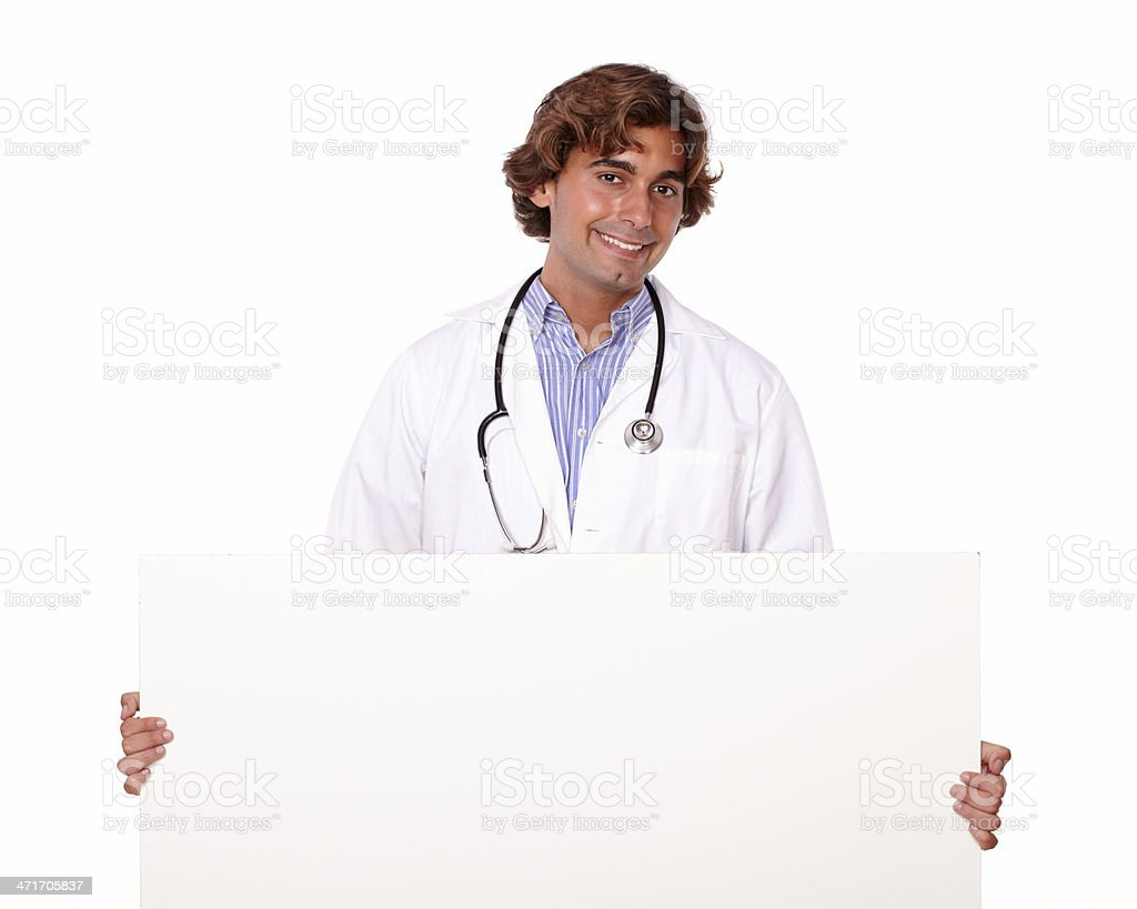 Handsome smiling doctor with blank placard royalty-free stock photo