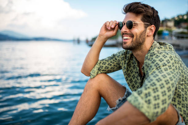 Handsome smiling man looking away. stock photo