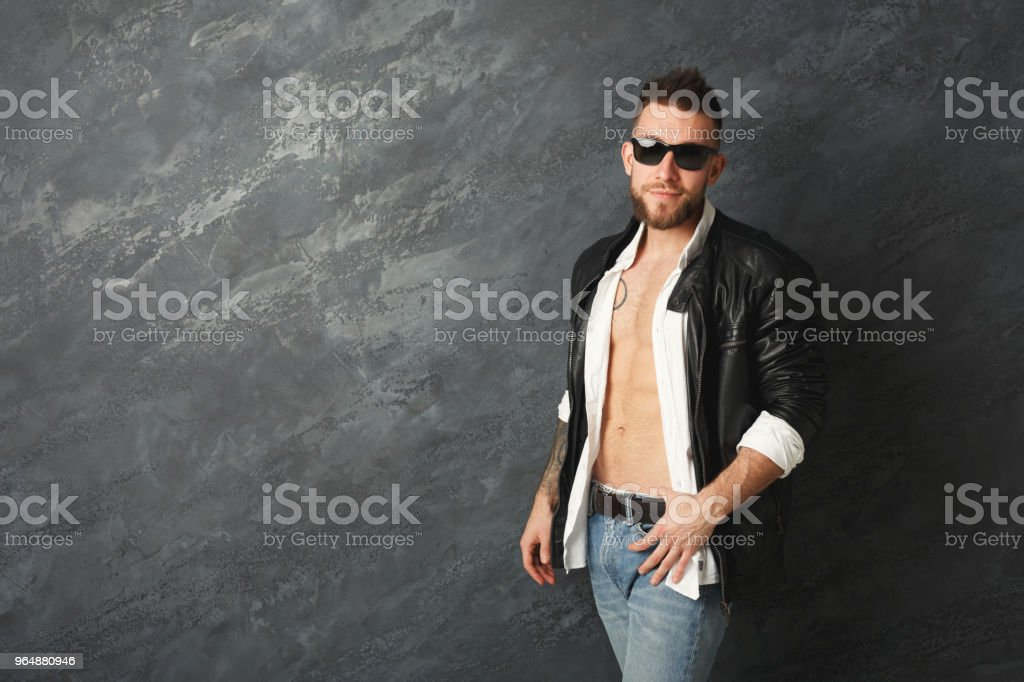 Handsome smiling man posing in studio royalty-free stock photo