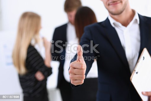 istock Handsome smiling man showing OK or approval sign 801187898