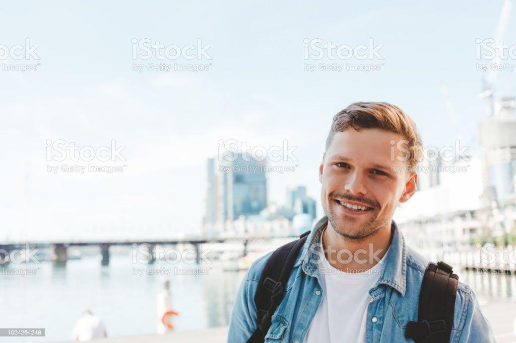 handsome smiling traveler stock photo