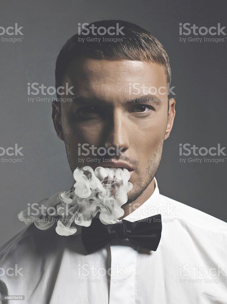 Handsome smoker stock photo