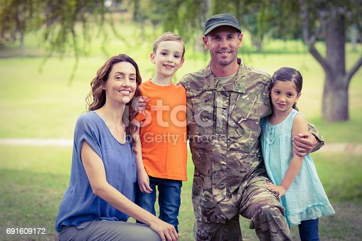 istock Handsome soldier reunited with family 691609172
