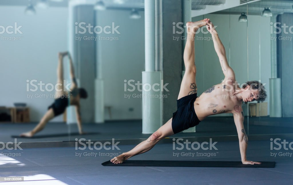 Handsome Tattooed Man Practicing Yoga Young Male Teacher Taking Side Plank Pose Vasisthasana Advanced Asana In Class On Black Mat Yogi Master Concept Stock Photo Download Image Now Istock