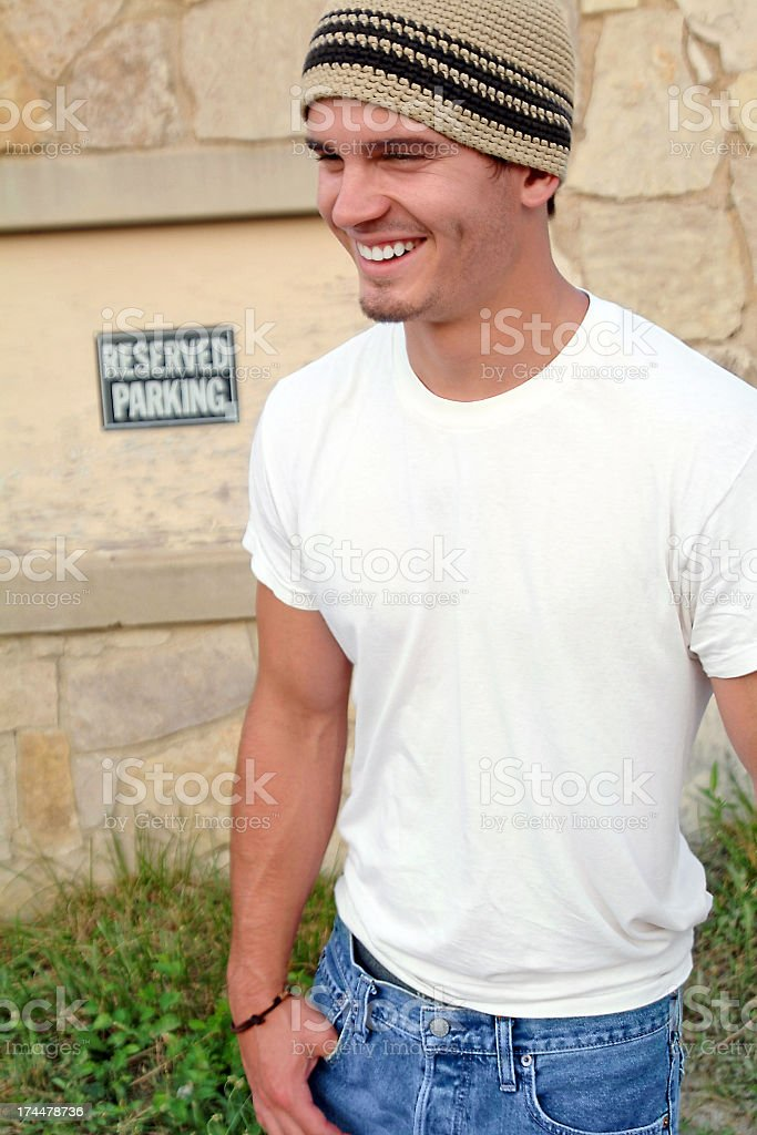 Handsome Teenage Boy Standing Outside with a White T-Shirt royalty-free stock photo