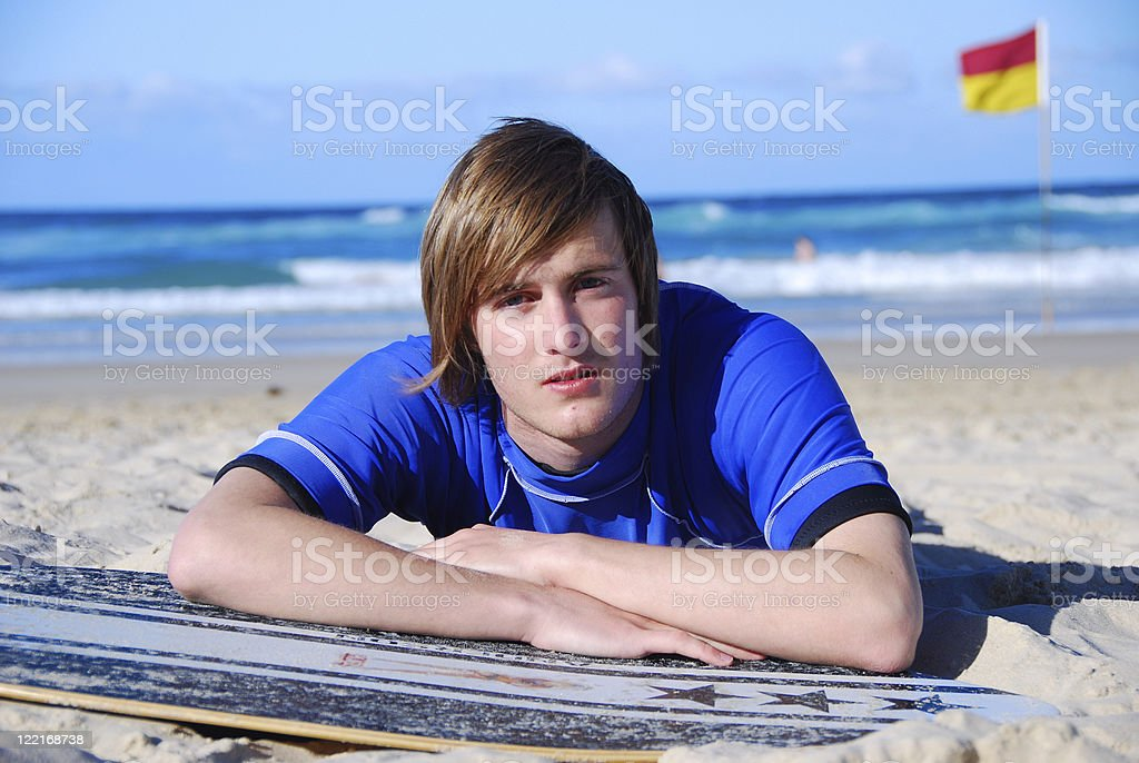 Handsome teenage, young adult male  lying on Beach royalty-free stock photo