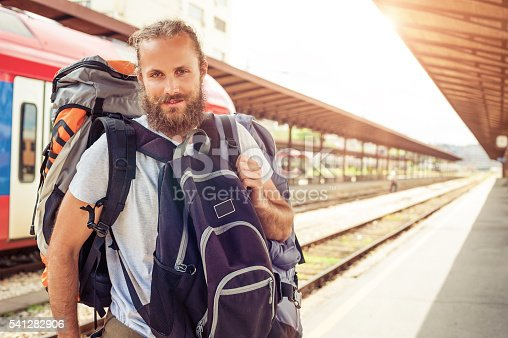 istock Handsome tourist traveler standing with huge luggage 541282906