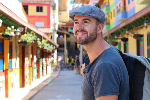 Handsome tourist visiting Guatape, Colombia Handsome tourist visiting Guatape, Colombia. southern charm stock pictures, royalty-free photos & images