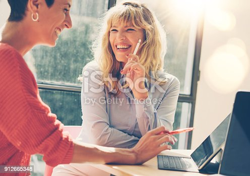 istock Handsome two businesswoman at job interview meeting at modern office place.Horizontal. Blurred background. 912665348
