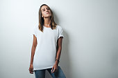 istock Handsome woman in white blank t-shirt, studio model 948336674