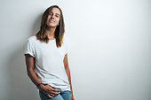 istock Handsome woman in white blank t-shirt, studio model 948336744