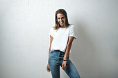 istock Handsome woman in white blank t-shirt, studio model 948336924