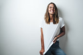 istock Handsome woman in white blank t-shirt, studio model 948337056