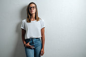 istock Handsome woman in white blank t-shirt, studio model 948337060