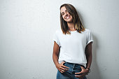 istock Handsome woman in white blank t-shirt, studio model 948337254