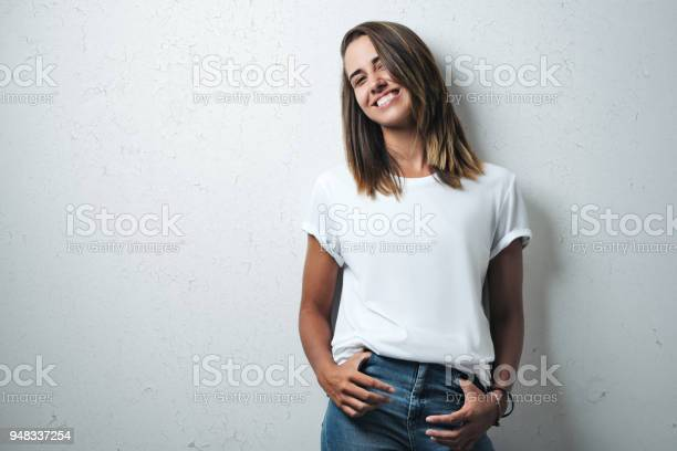 Handsome woman in white blank tshirt studio model picture id948337254?b=1&k=6&m=948337254&s=612x612&h=lpcssvo7qwyx2uxgsout4mvsmxfocwznsapzvsciqss=