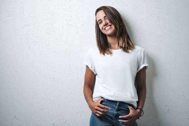 handsome woman in white blank t-shirt, studio model - t shirt stock photos and pictures