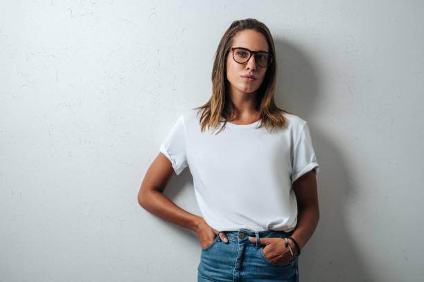 Handsome woman in white blank t-shirt, studio model stock photo
