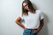 istock Handsome woman in white blank t-shirt, studio model 948337436