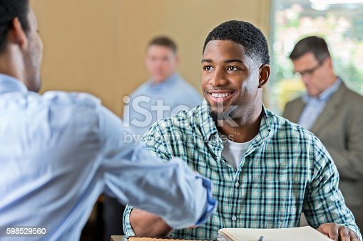 istock Handsome young African American man at job interview 598529560