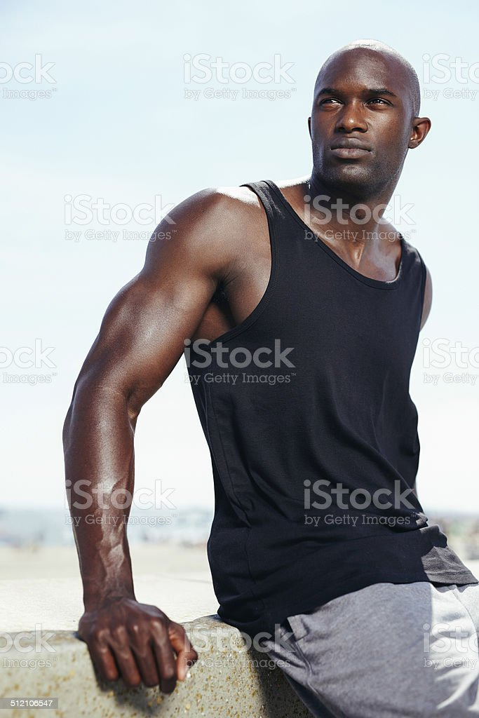 Handsome young african male model looking away. stock photo