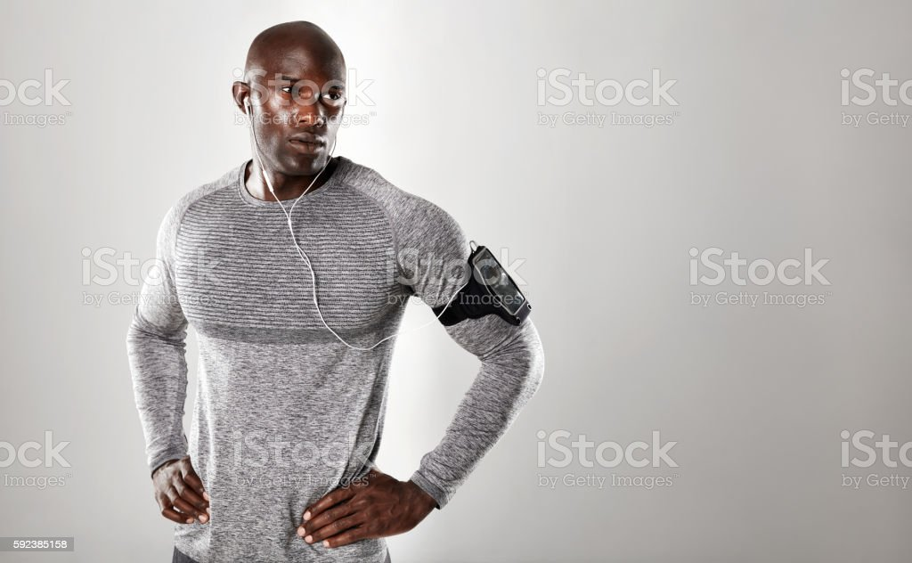 Handsome young african man looking at copy space stock photo