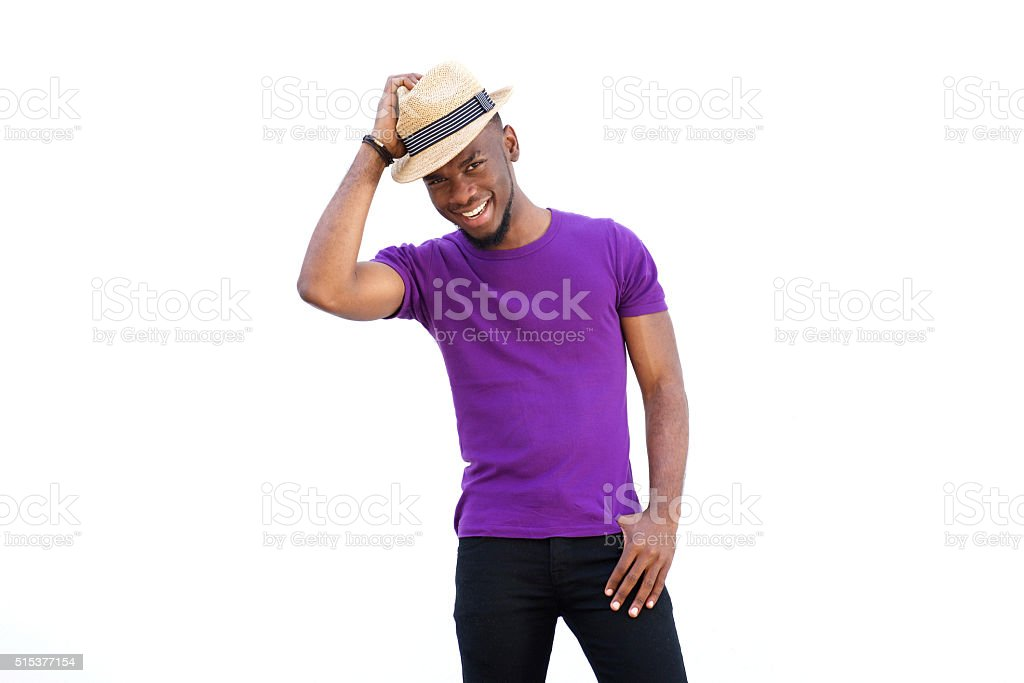 Handsome young african man with hat smiling stock photo