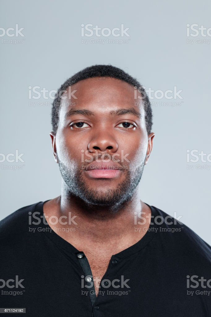 Handsome young afro american guy face stock photo