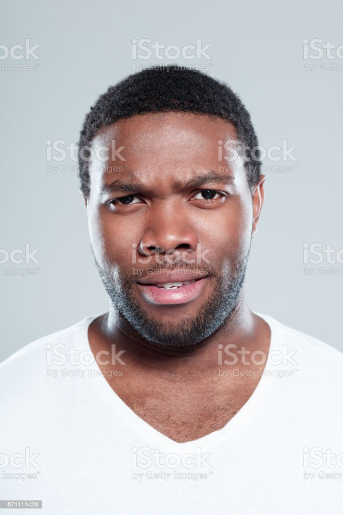 Handsome young afro american man staring at camera stock photo