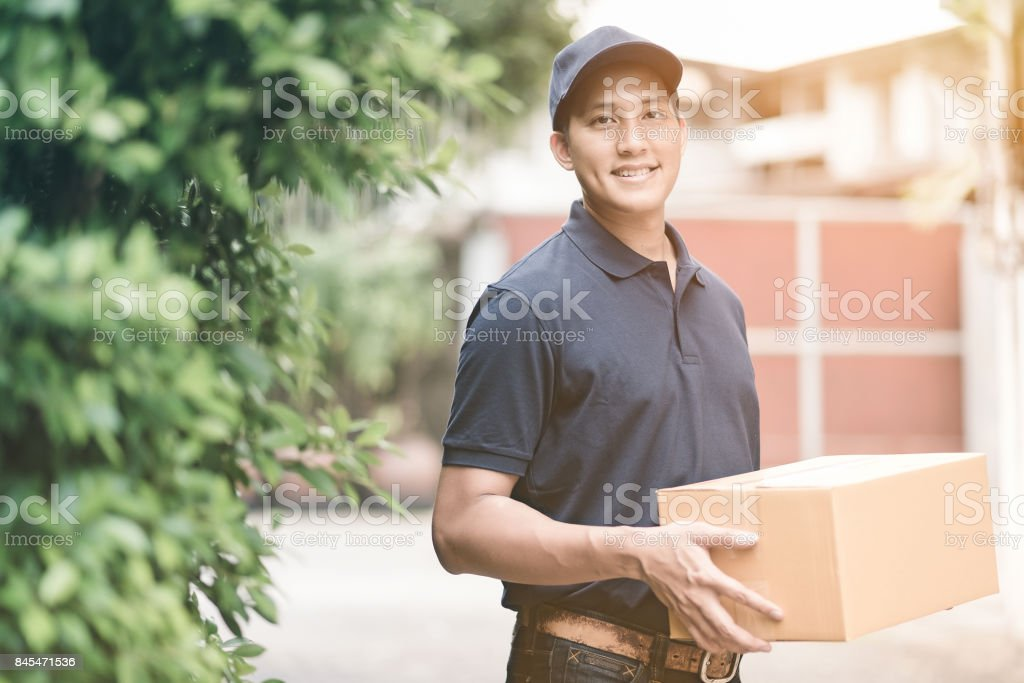 Handsome young asian delivery man stock photo