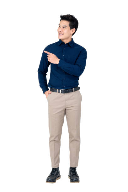 Handsome young Asian man wearing smart casual clothes Studio portrait of sophisticated handsome smiling young Asian man wearing semi formal clothing while pointing at space aside alongside stock pictures, royalty-free photos & images