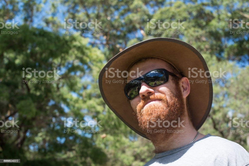 Handsome young Australian man in the bush stock photo