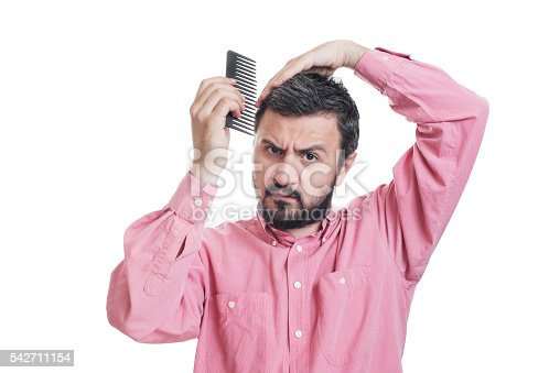 1134770826 istock photo Handsome young beard man combing his hair 542711154