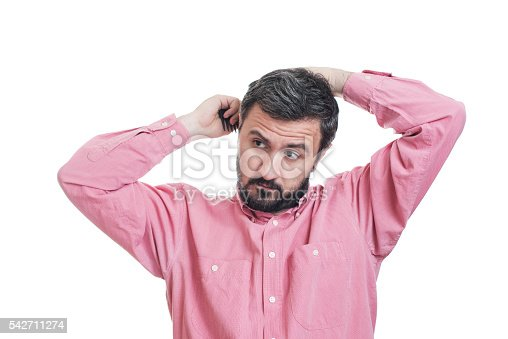 1134770826 istock photo Handsome young beard man combing his hair 542711274