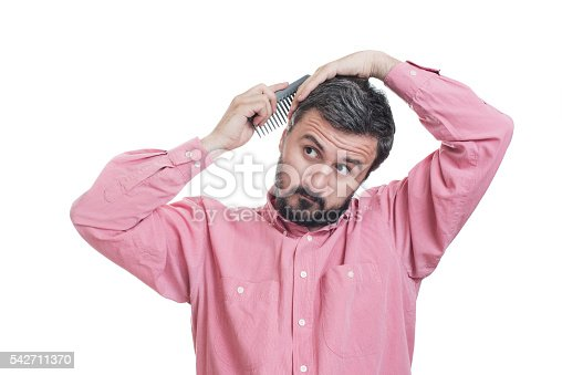 1134770826 istock photo Handsome young beard man combing his hair 542711370