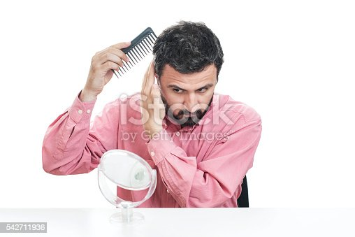 1134770826 istock photo Handsome young beard man combing his hair 542711936