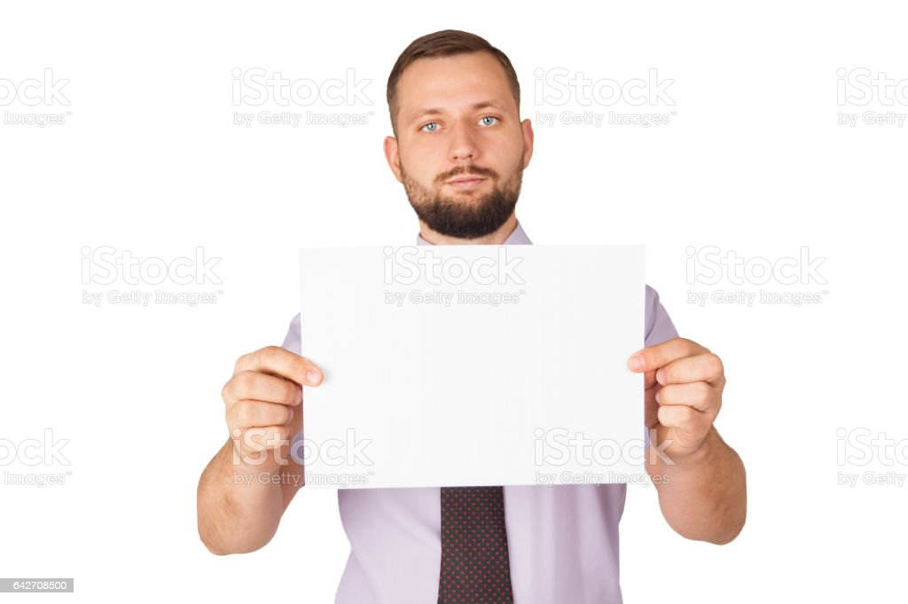 Handsome young bearded businessman holding a blank sheet of paper stock photo