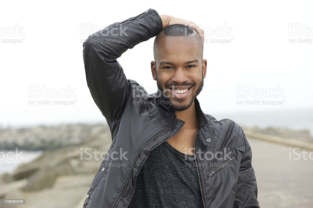 Handsome young black man smiling outdoors royalty-free stock photo