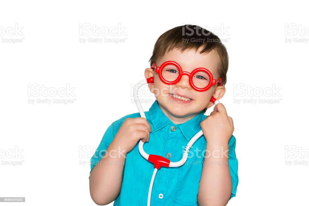 Handsome young boy with glasses. Little doctor with glasses stock photo