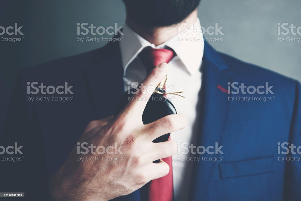 handsome young business man using perfume royalty-free stock photo